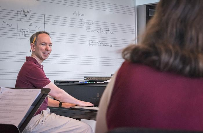 Gregory Ristow at piano with student.