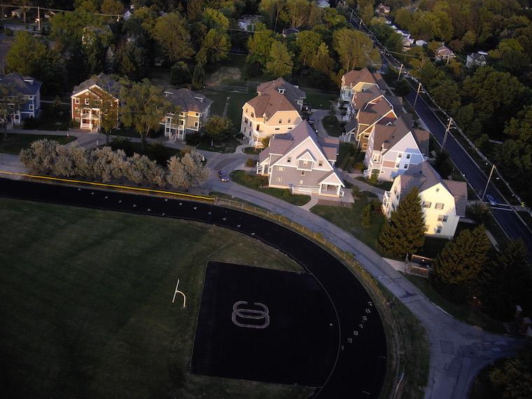 Aerial view of Village Housing and the college track