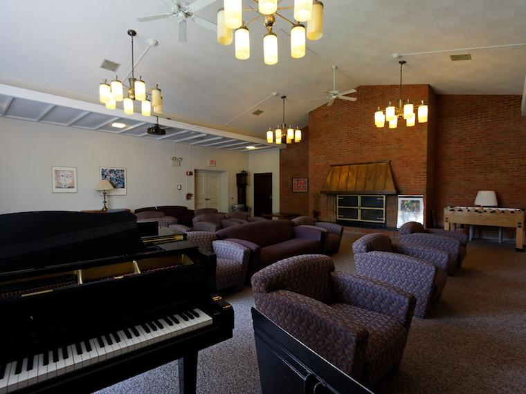Inside of Kade House lounge with piano and couches