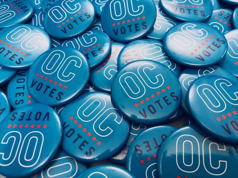 collection of voter buttons.