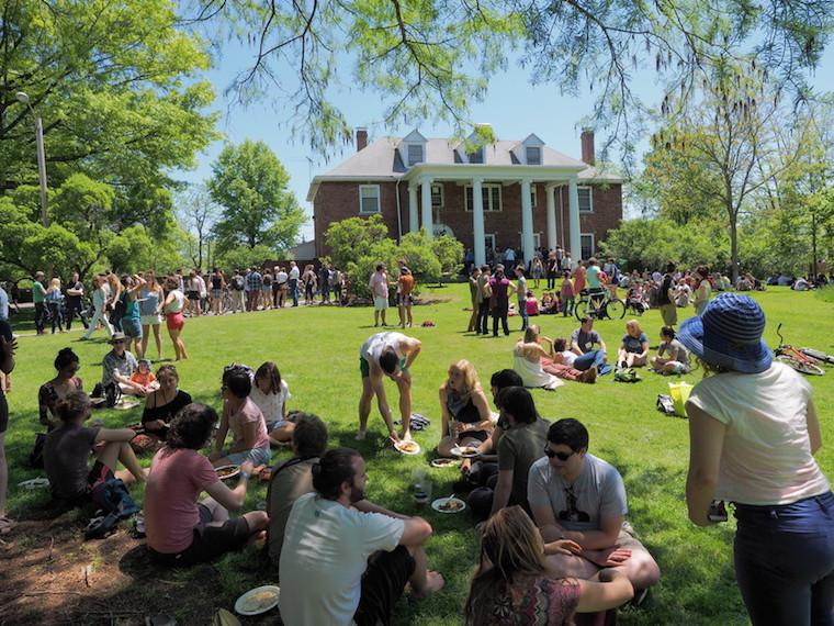Photo of alumni socializing at a reunion on the green in front of Old Barrows.