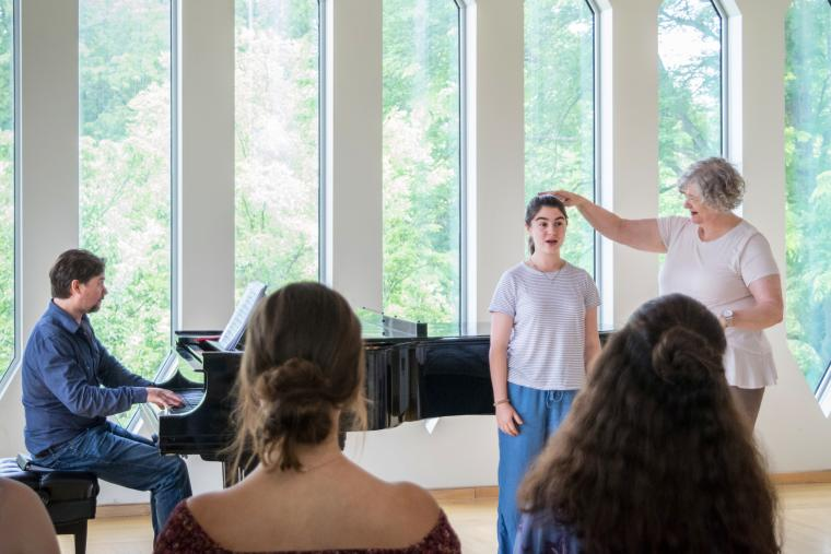 A summer vocal academy student singing in a master class.