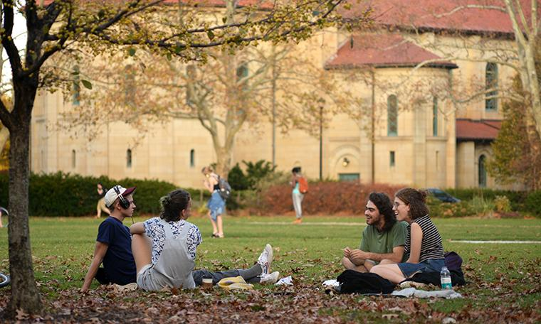 Students sitting outdoors