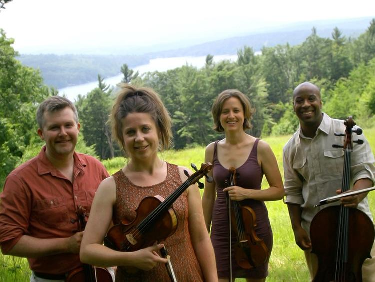 Apple Hill String Quartet standing with their stringed instruments.