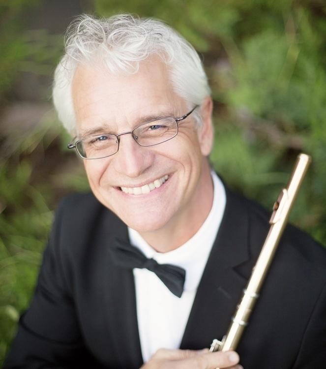 Headshot of Mark Sparks in a tuxedo with his flute
