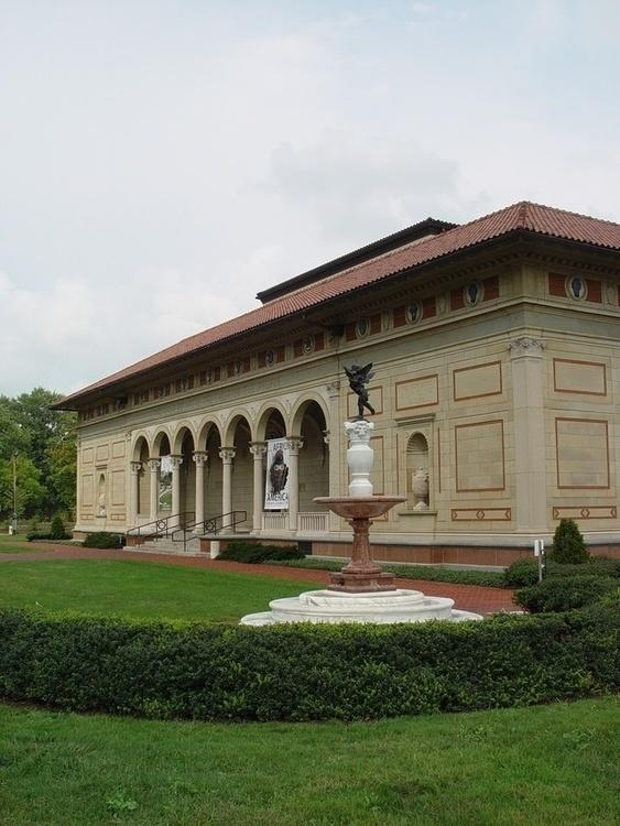 exterior view of sandy colored museum building.