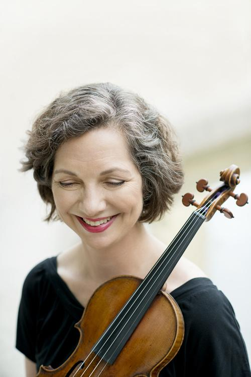 Violaine Melancon holding her violin and smiling