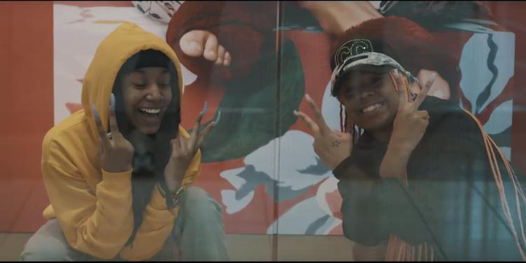 side by side images of two females posed in front of a mural.