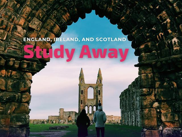 Students walk through arch in Scotland.