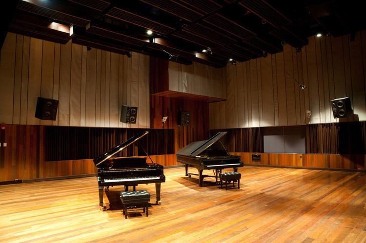 Interior of Clonick hall with 2 pianos displayed.