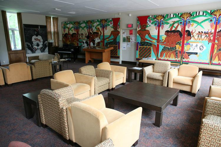 lounge area of Afrikan Heritage House with 6 lounge chairs surrounding a small table.