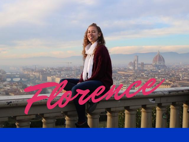 Student sits on balcony overlooking Florence.