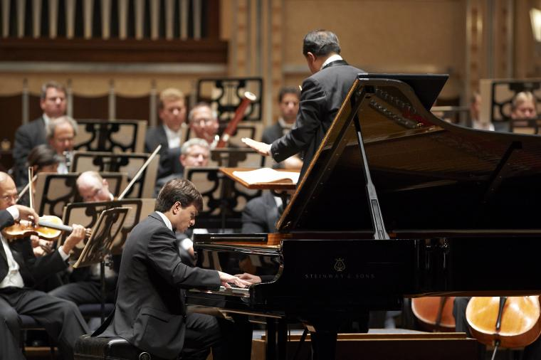 Pianist performs with orchestra