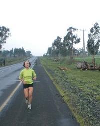 Joanna Johnson '11 running along an asphalt path.