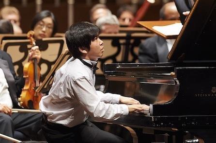 Yang performs at the piano