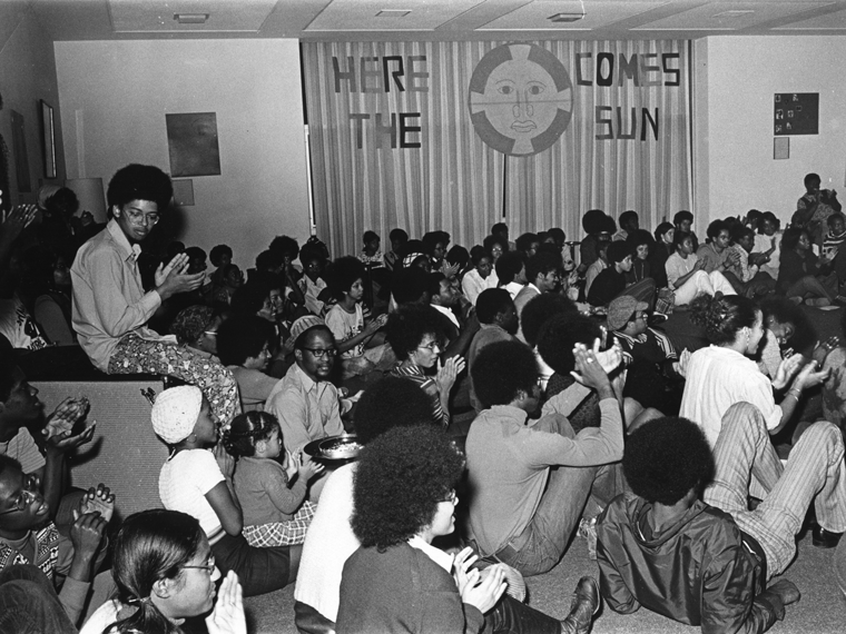 gathering of students inside what is now known as Afrikan Heritage House in the early 1970s at Oberlin.