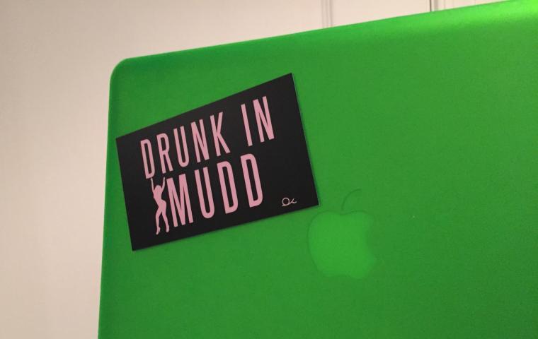 Sticker on a computer says 'Drunk in Mudd'