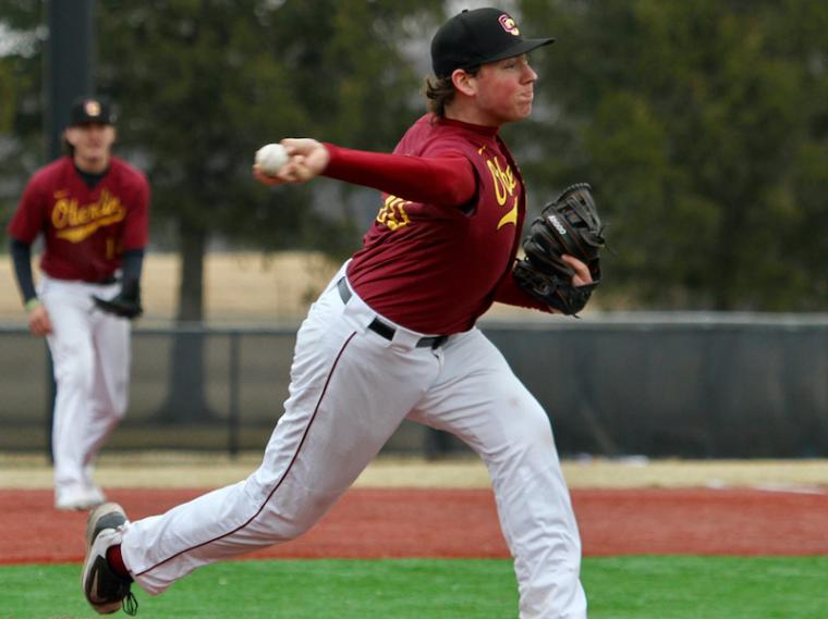 Oberlin baseball player Ian Ashby throwing a pitch.