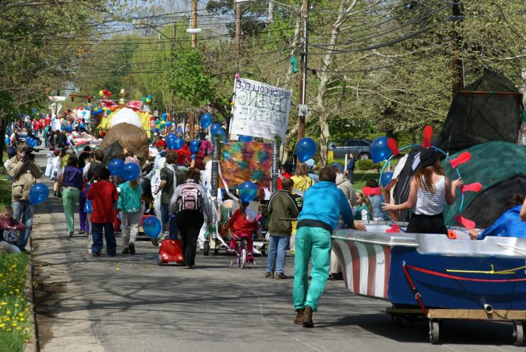 Parade participants march down the street.