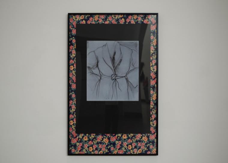 Framed fabric on display