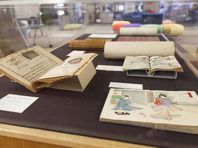 Japanese books on display in an exhibit case