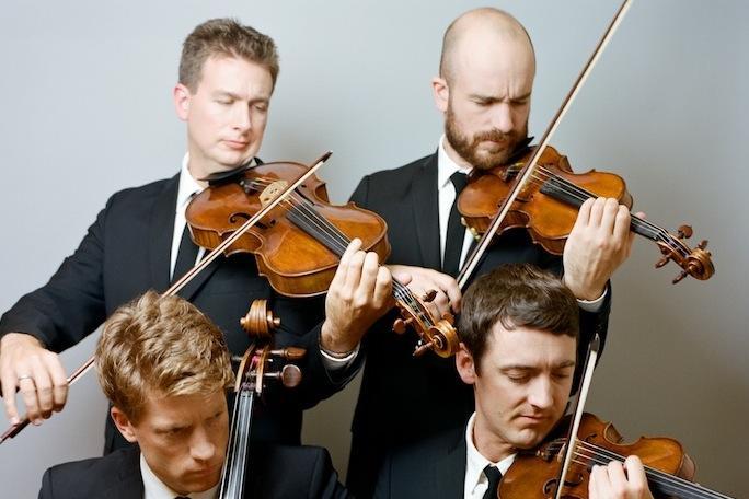 Calder Quartet playing violins