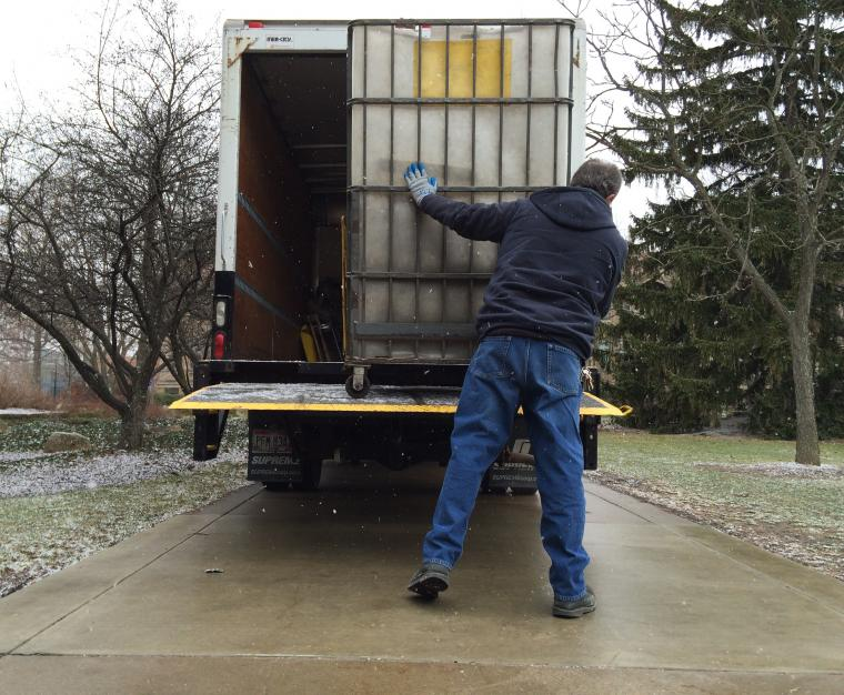 Loading letters onto the mail truck