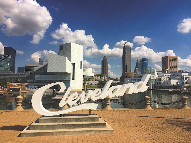 Cleveland script sign on brick platform.