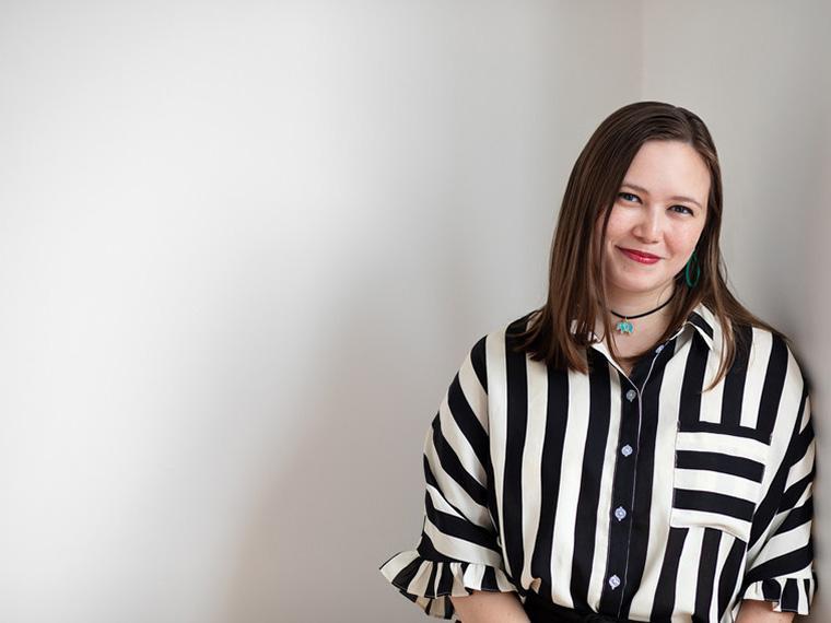 photo of Cora Hasegawa wearing balck and white striped shirt.