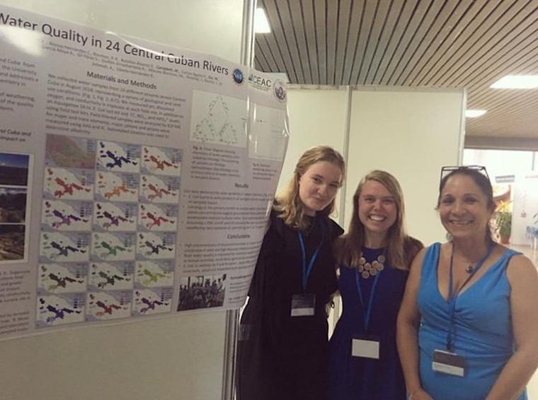 From left: Monica Dix '20, Mae Kate Campbell '17,  Rita Sibello Hernandez in front of research poster