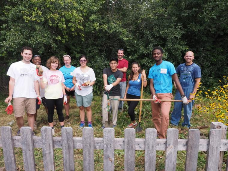 Day of Service volunteers remove bricks and invasive plant species at Prospect Elementary School