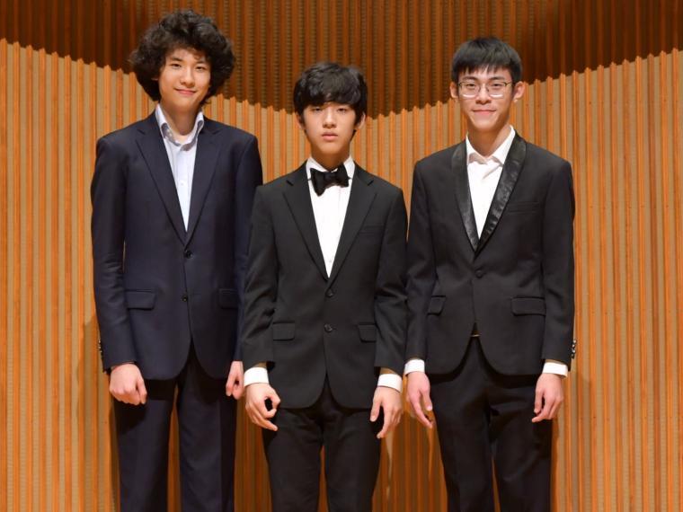 Three boys in formal attire