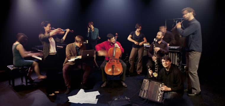 The 10 members with their instruments