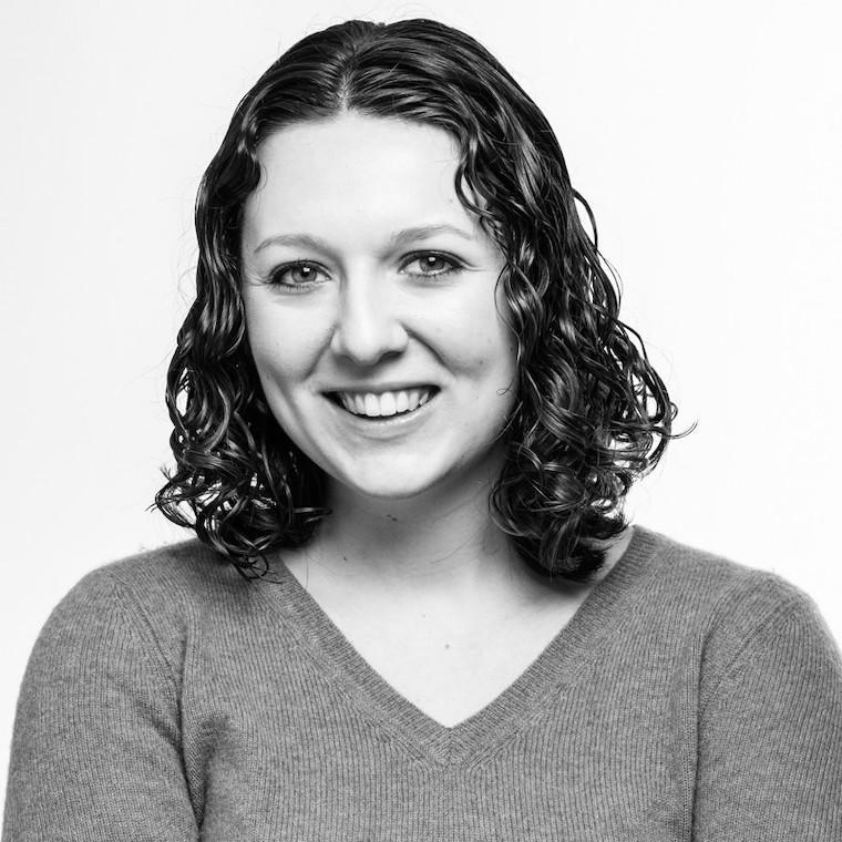 Black and white headshot of Emma Eisenberg.