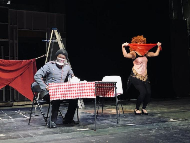 Two actors performing on a stage.