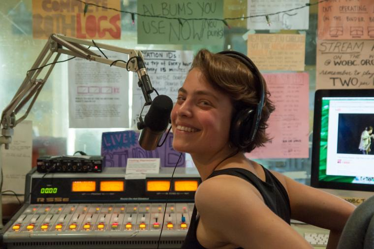 Rebecca at the microphone and sound console.