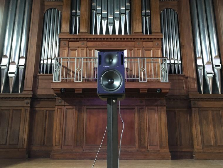 speaker mounted on the stage of Finney Chapel.