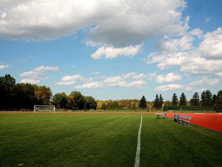 Fred Shults Field with a blue sky and clouds.