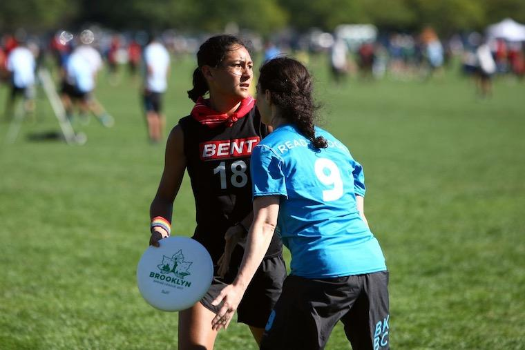 Action shot of Abbey Cheng playing ultimate