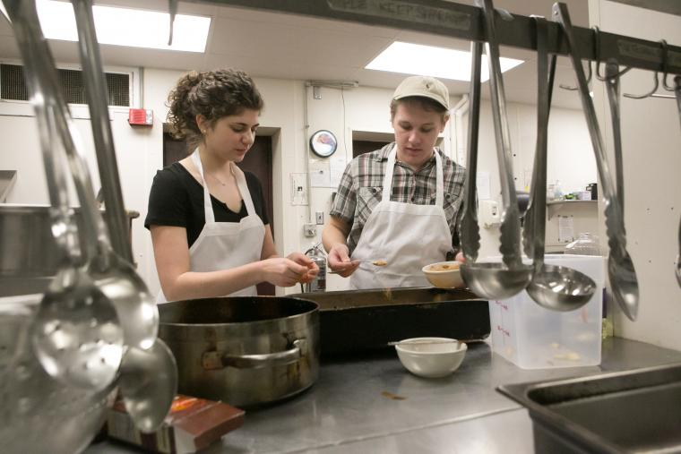Students serving a meal in Harkness coop