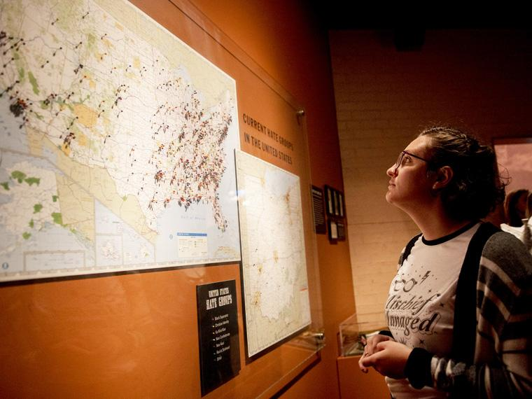 student looks at map mounted on wall.
