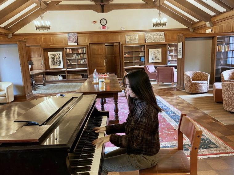 piano student practicing in Asia House lounge.