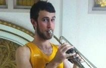 An athlete plays a trumpet