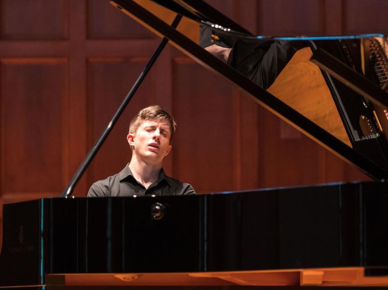 man performing at the piano.