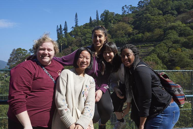 Five students pose at the Kadoori Farm and Botanic Garden in Hong Kong