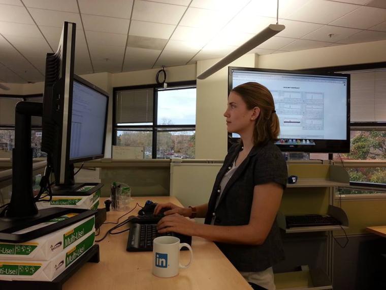 Liz Bennett working at her desk