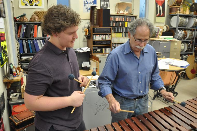 Professor Rosen and a student play marimba in the percussion studio.