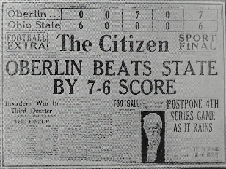 newspaper front page with football score.