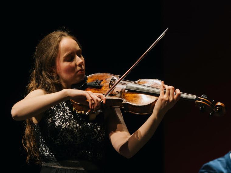female violist performing