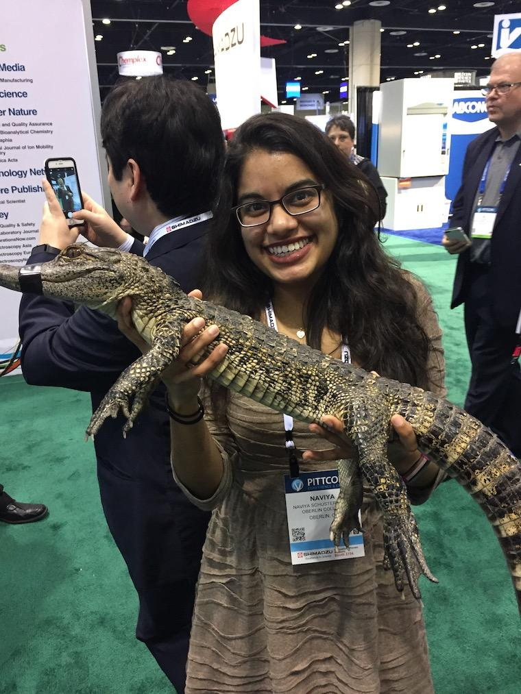 Image of Naviya Schuster-Little with an alligator